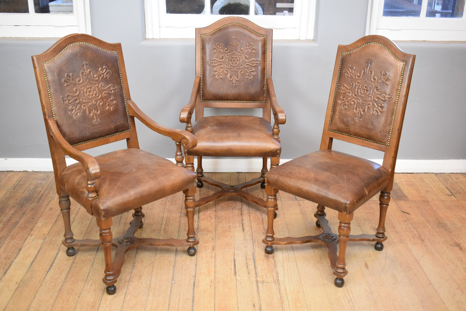 A SET OF EIGHT ITALIAN LEATHER STUDDED DINING CHAIRS ...